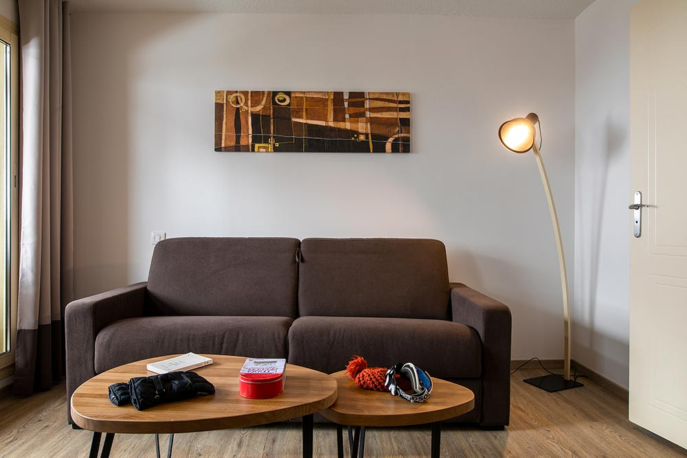 Le salon et son canapé convertible
