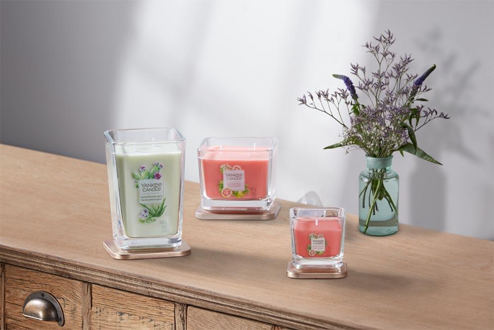 Yankee Candle Elevation - des bougies au design sophistiqué dont le couvercle sert de support.